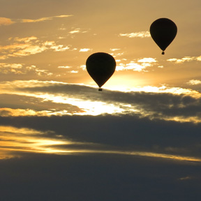 hot air balloon flying over franklin tennessee golden sky
