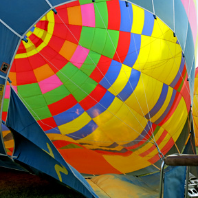 passengers around a hot air balloon