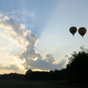 hot air balloon rays of sunshine